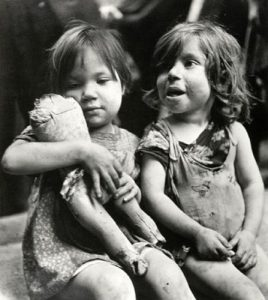 Photojournalist x captured this image of two girls in post-war Naples. The f