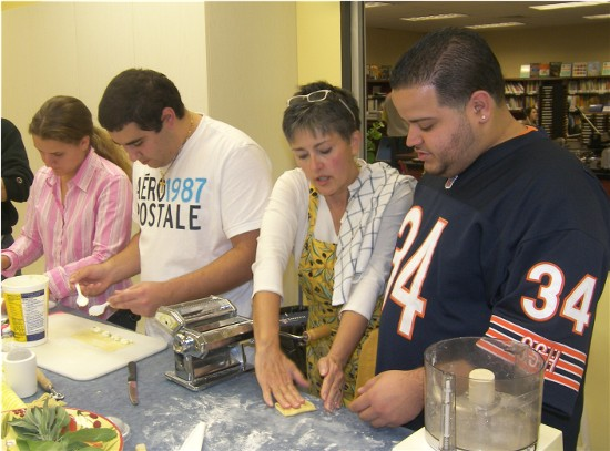 (Left to right) Michele and Eddie fill and cut ravioli while Sharon shows Eddie how to prepare the dough for rolling.