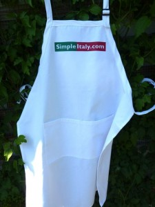 """Cook Italian, Be Happy"" in this stylish chef's apron."