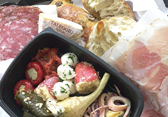 Cured meats, cheese, rustic bread, and assorted antipasti make a pranzo perfetto.