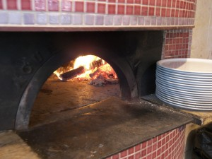 The Piccolo Forno oven consumes a cord of kiln dried oak, cherry and maple wood every three months.