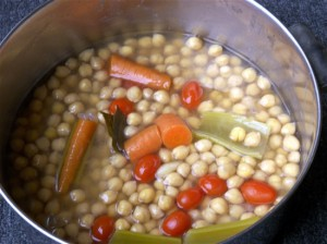 Dried chickpeas soak overnight before being simmered with aromatics.
