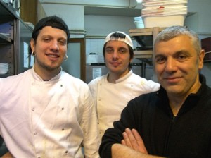 Chef Clemente Maiorano (right), son Alessandro (left), and another sous chef in the Clemente kitchen.
