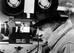 Federico Fellini, behind the camera, creating another film classic.