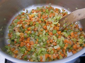 The soffrito should be lightly caramelized but not browned. This sauteed vegetable mixture is the flavor base of ragu.